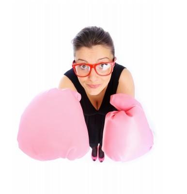 vrouw met bokshandschoenen vraagt zich af 'Hoe word je succesvol?'
